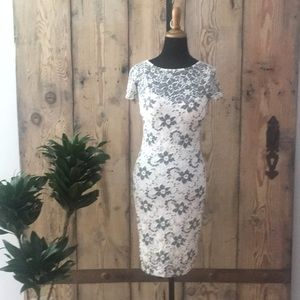 White lace dress with slip.